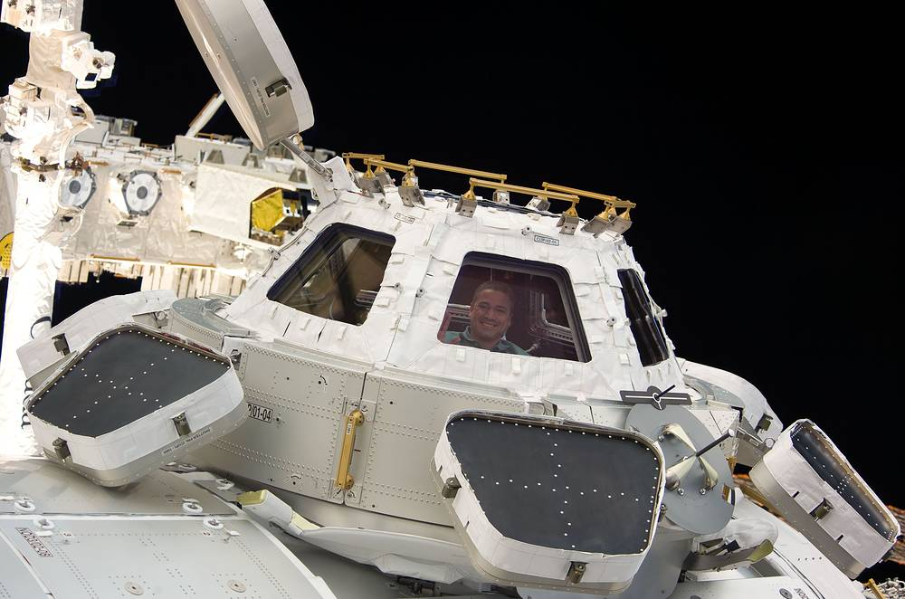 Cupola, ESA-built observatory module of the ISS was delivered to the station in 2010. Photo: Astronaut George Zamka in a window of the newly-installed Cupola of the International Space Station, 2010