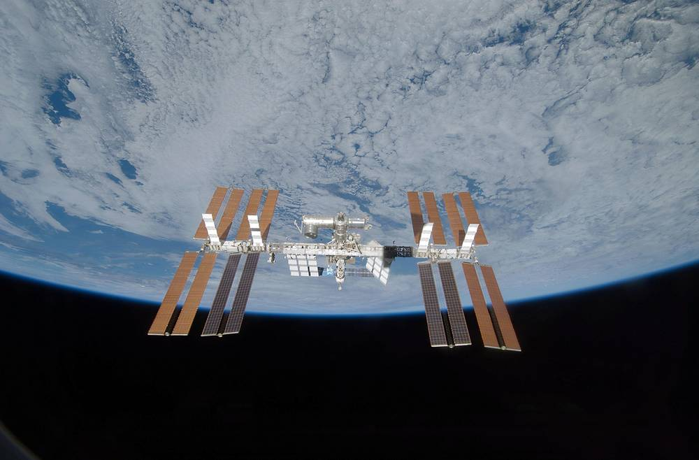 The station is divided into two sections, the Russian Orbital Segment (ROS) and the United States Orbital Segment (USOS), which is shared by many nations. Photo: International Space Station seen from space shuttle Discovery, as the two spacecraft begin their relative separation, 2009
