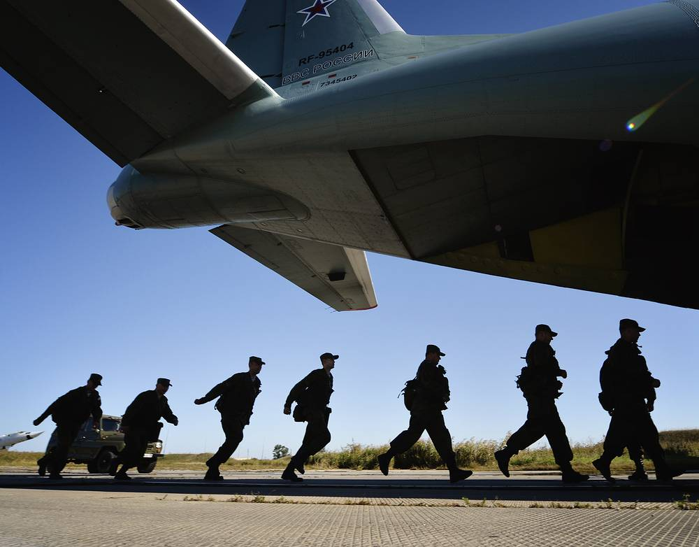 Officers board a plane before a combat readiness check in Russia's Eastern Federal District