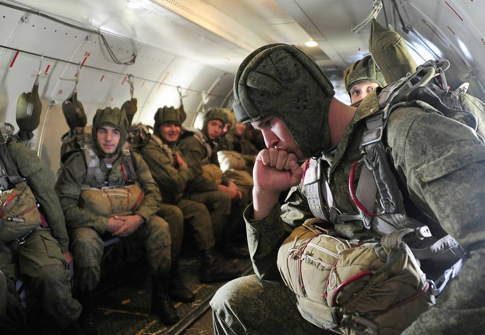 Paratroopers prepare to jump from a plane during a combat readiness check in Russia's Eastern Federal District