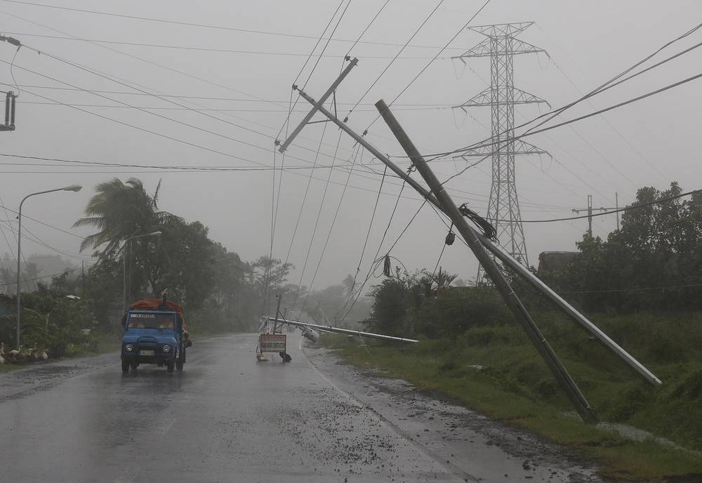 Photo: Toppled electrical posts in Camalig, eastern Philippines, December 7, 2014