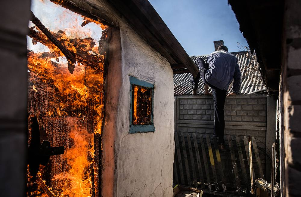 A house on fire after a mortar attack on Donetsk