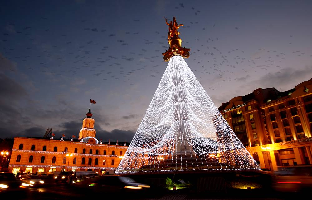 A statue of St. George decorated like a Christmas tree in the center of Tbilisi, Georgia