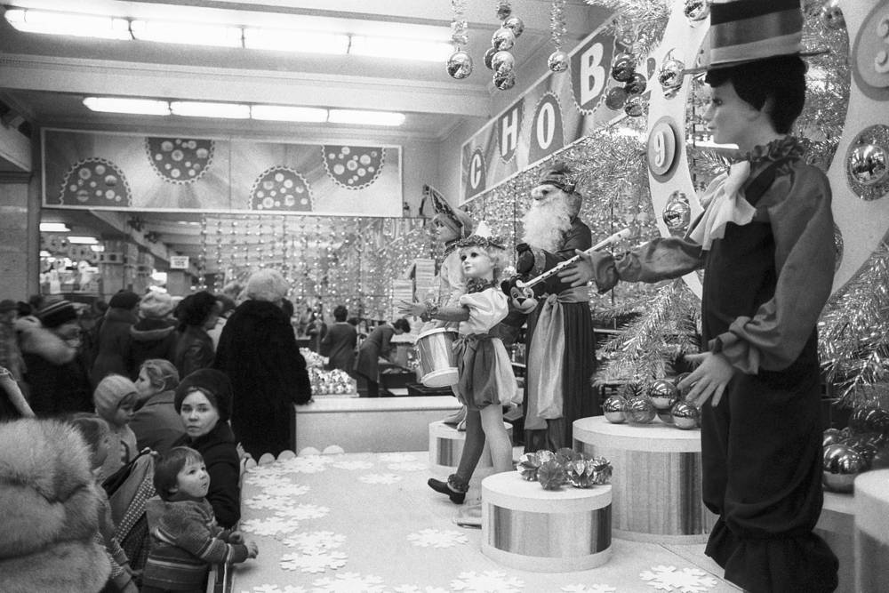 Customres near the shopwindow of Children's World toy store, 1983