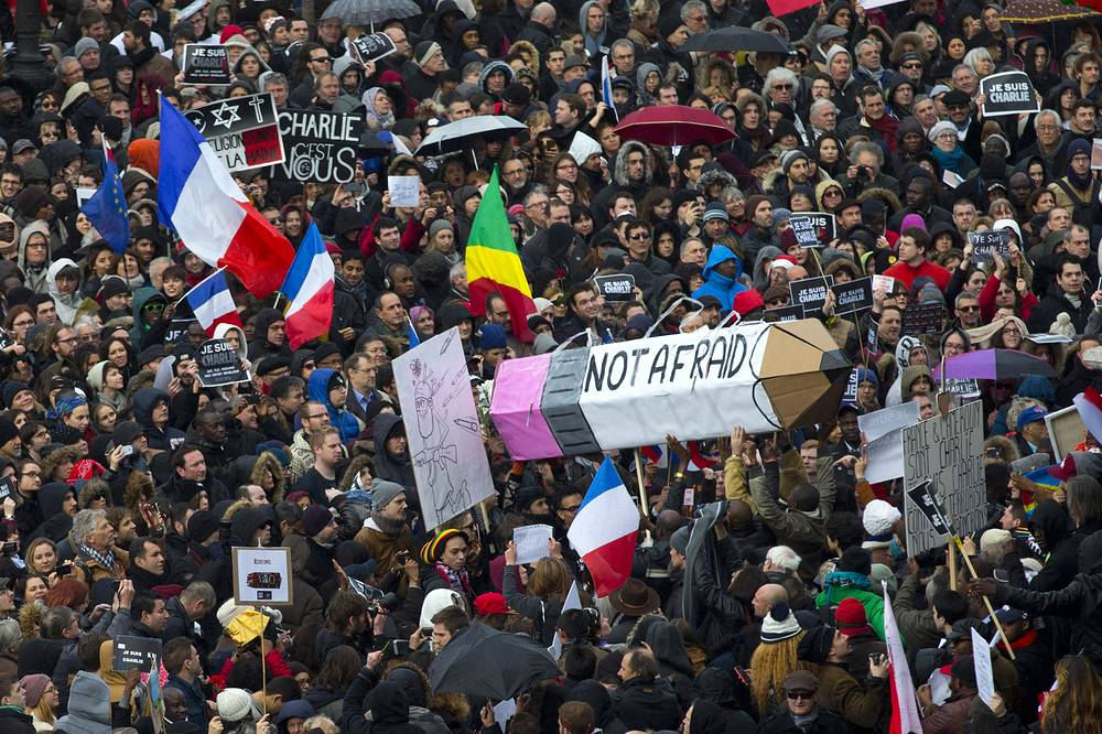 Photo: Crowd gathering at Republique square in Paris