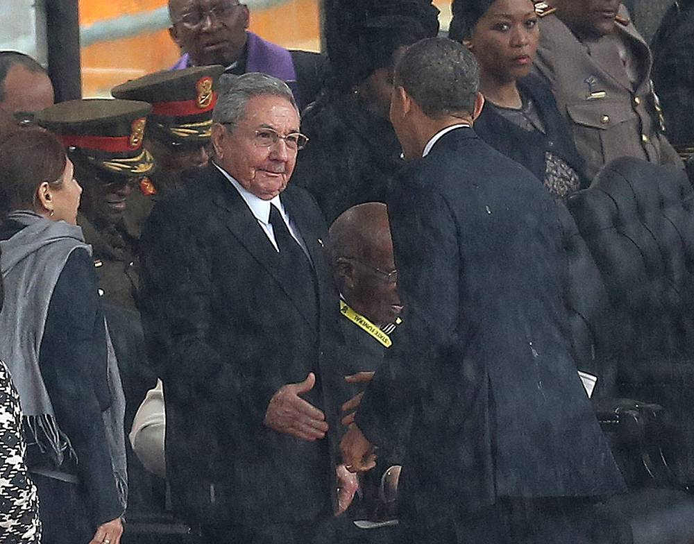 After coming to power in 2009, US President Barack Obama stated his intention to begin a dialogue with Cuba. Photo: US President Barack Obama shakes hands with Cuban President Raul Castro, as it rains during a memorial service for former South African President Nelson Mandela in South Africa, December 10, 2013. The handshake set off speculation in the US and Cuba about whether it signaled a warming of ties between the two nations after decades of animosity