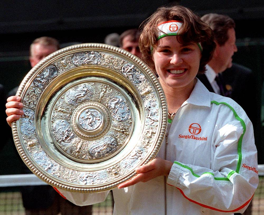 Tennis star Martina Hingis was banned for two year from sport after being tested positive for cocaine in 2007. Photo: Martina Hingis holds her trophy, after defeating Jana Novotna in the Women's Singles final at Wimbledon, 1997. Hingis became the youngest winner of the championship