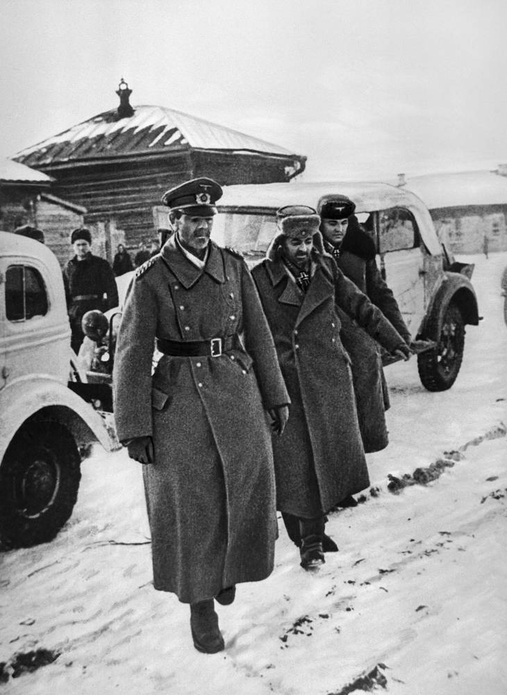 German Field Marshal Friedrich Paulus (front) and members of his staff moving towards the headquarters of the Soviet Army