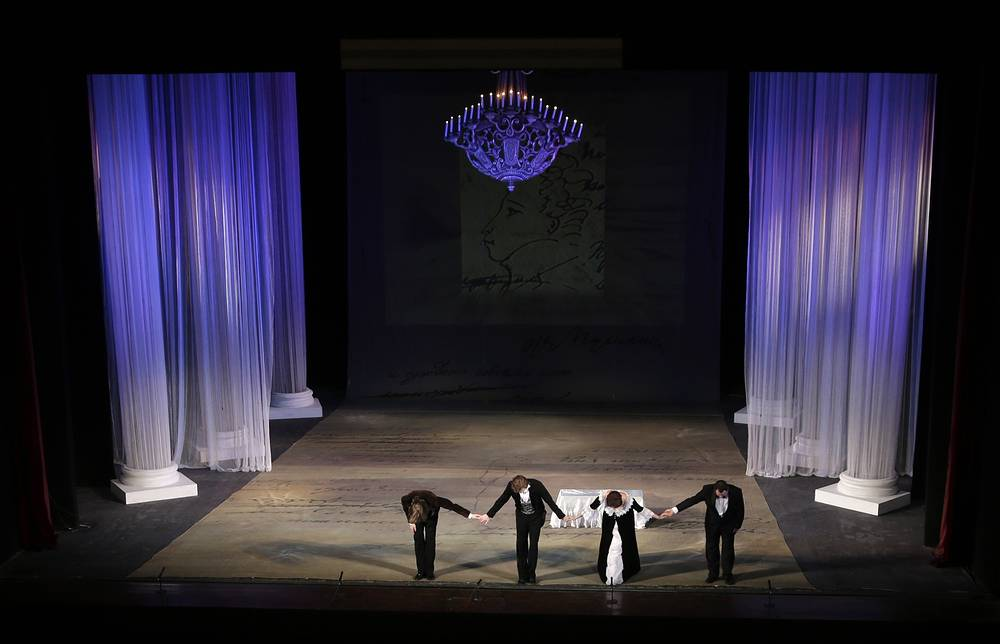 Actors with the Donbas Opera Theater take their bow after a performance of Eugene Onegin in Donetsk, Ukraine