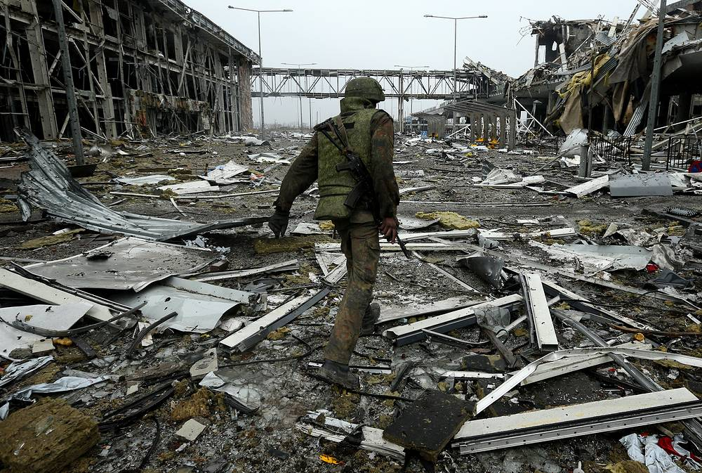 Self-proclaimed Donetsk People's Republic holds a humanitarian cooperation in the area of Donetsk airport to clear the terrain of mines and to recover the bodies of those dead in combat actions. Photo: Militia man of the Donetsk region patroling the destroyed Donetsk airport