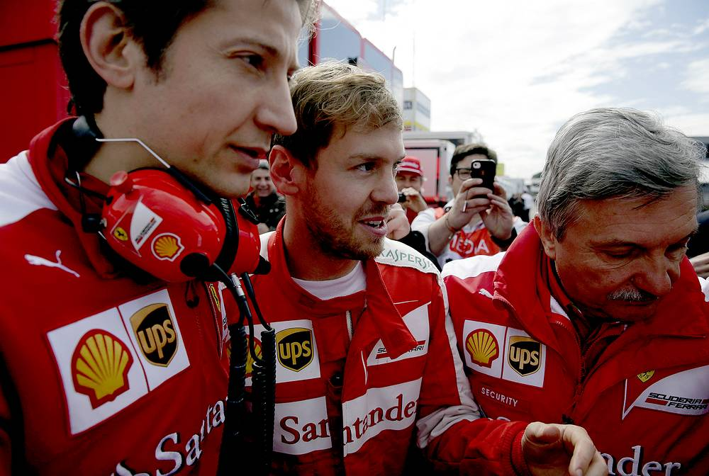 German Formula One driver Sebastian Vettel of Ferrari speaking with the team manager of Ferrari, Massimo Rovola during third pre-season tests in Spain