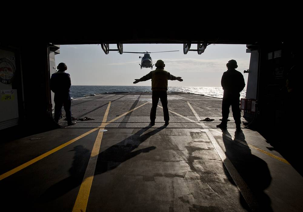 A helicopter landing on the deck of the Italian warship Aliseo