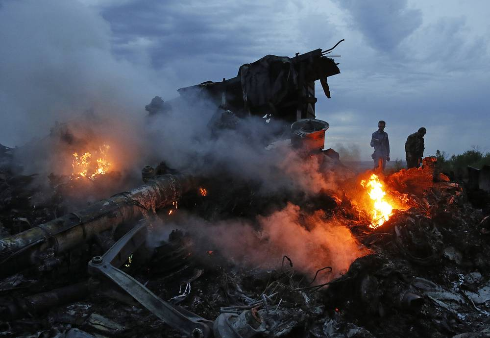 Malaysia Airlines Flight 17 from Amsterdam to Kuala Lumpur crashed on 17 July 2014 after being shot down, killing all 283 passengers and 15 crew on board. Photo: Site of the crash of a Malaysia Airlines Boeing 777 flight from Amsterdam to Kuala Lumpur, 60 km east of the Ukrainian Russian border