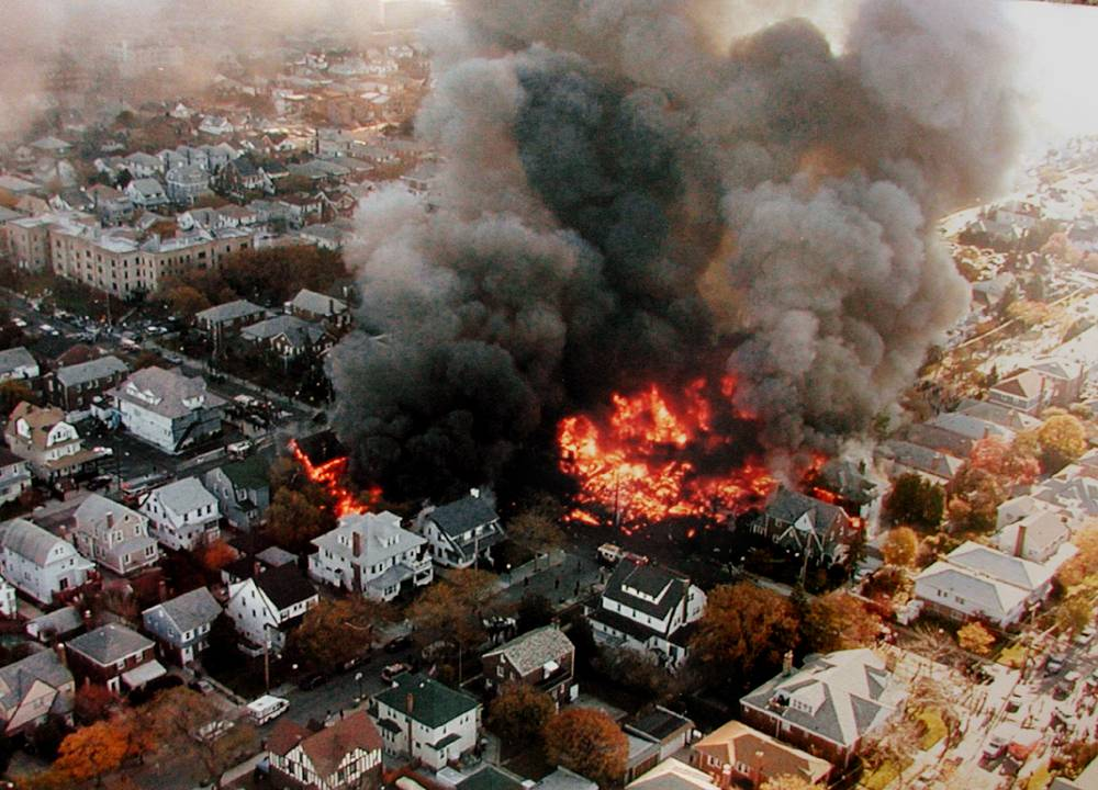 On November 12, 2001, the Airbus A300-600 flying the route from the New York City to Santo Domingo crashed shortly after takeoff. 265 people were killed. Photo: Fires burning in New York's Rockaway neighborhood, from the crash of American Airlines Flight 587