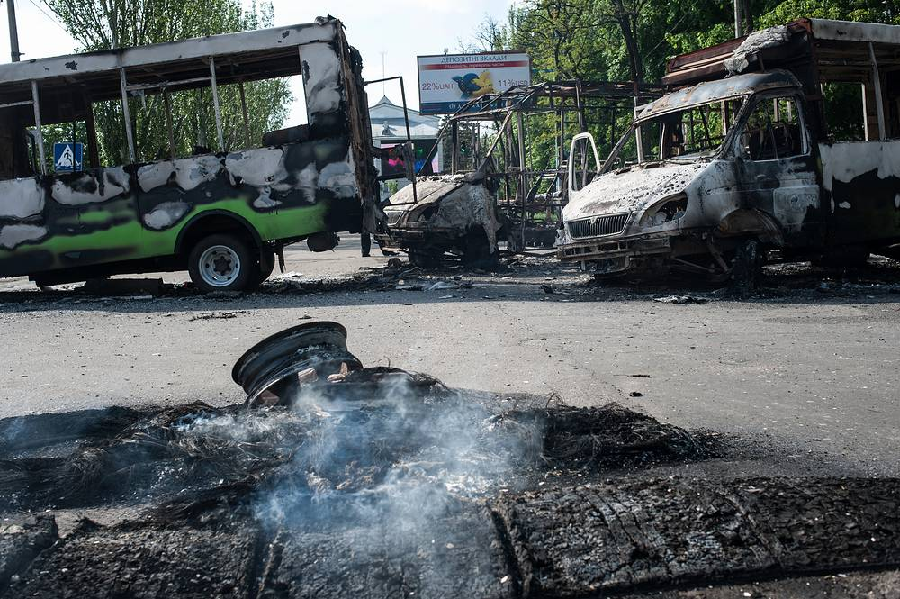 Charred skeletons of vans and a bus after the fighting and shelling in Kramatorsk , Ukraine, May 2014