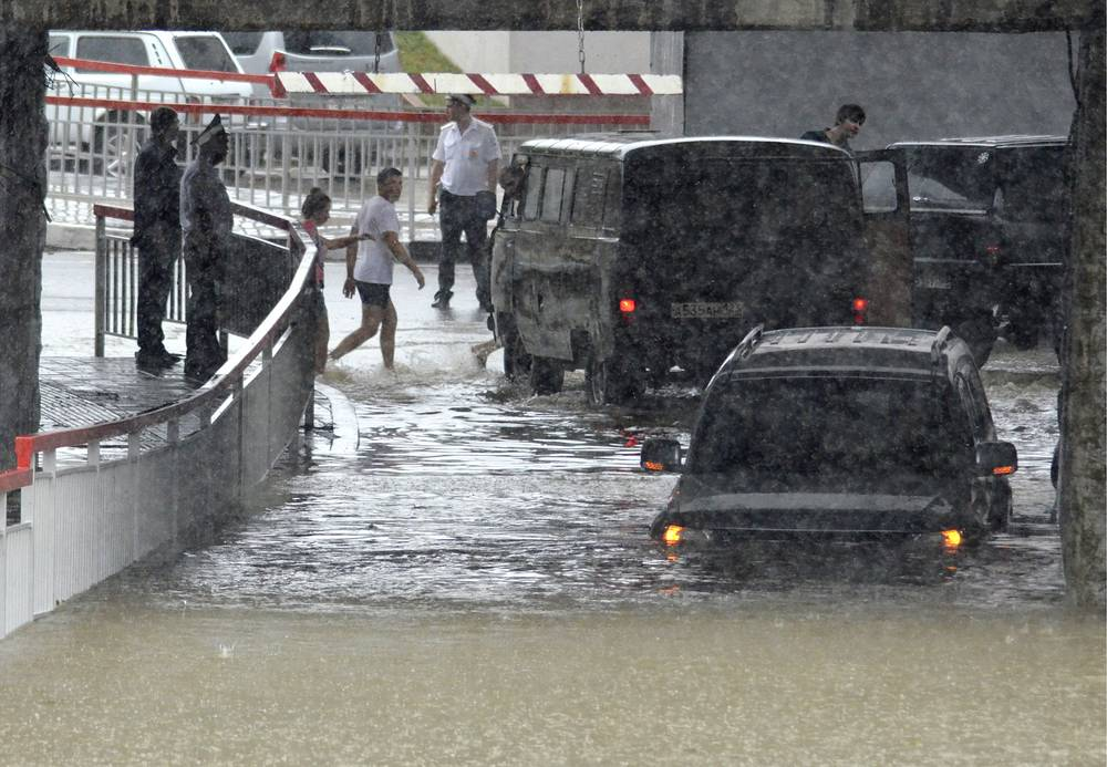Floods turned some Sochi roads into rivers with many cars left completely underwater