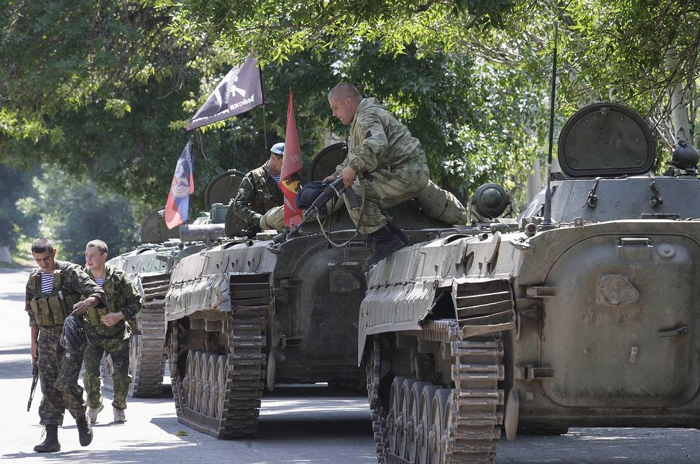 """""""The [OSCE] Special Monitoring Mission, along with media representatives [...] observed a column of three MBTs (T-64) move approximately 1.28km south-east and into a forest near the town,"""" the OSCE report said"""