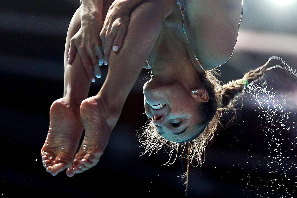 Italy's Tania Cagnotto competing to win gold in women's 1m springboard final, July 28