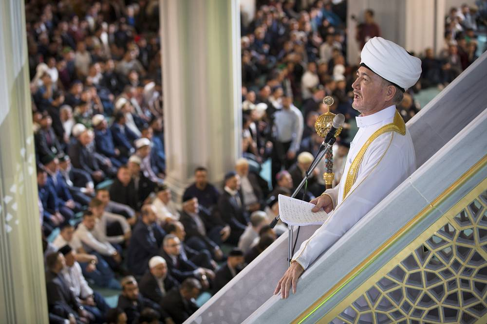 Russia's top Muslim Cleric Ravil Gainutdin, right, conducted a religious service inside the newly restored Moscow Cathedral Mosque