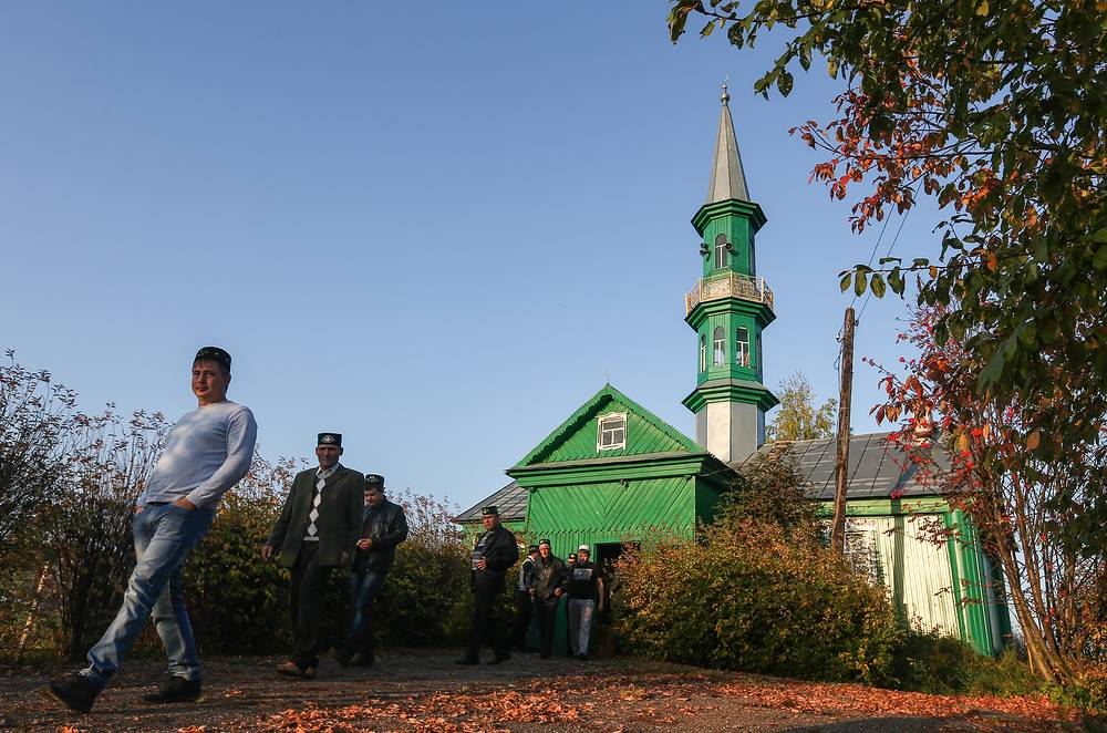 Russia is home to a total of 23 million Muslims representing 38 peoples, according to the Council of Muftis. Photo: Muslims seen outside a mosque in the village of Nizhniye Meteski, Tatarstan