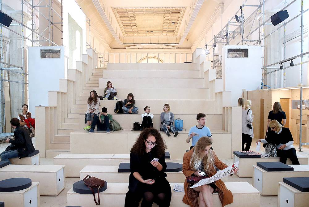 Visitors at a cinema auditorium of the 6th Moscow Biennale of Contemporary Art at Moscow's VDNKh Exhibition Center