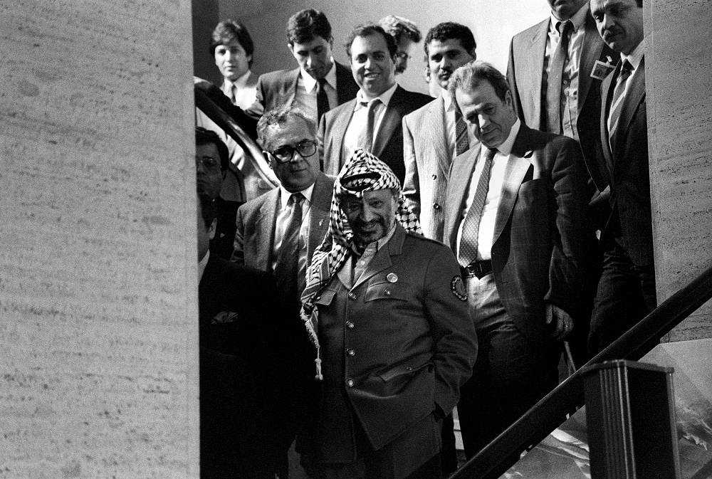 """On November 13, 1974 Palestinian leader Yasser Arafat made his first appearance at the UN General Assembly and, in particular, said, referring to Israel: """"Today I come bearing an olive branch in one hand, and the freedom fighter's gun in the other. Do not let the olive branch fall from my hand"""""""