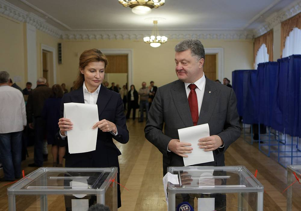 Ukrainian President Petro Poroshenko and his wife Maria casting their ballots at a polling station during local election in Ukraine