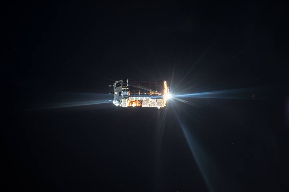 Distant view of Japan Aerospace Exploration Agency Kounotori 5 H-II Transfer Vehicle (HTV-5) during its final approach for docking with the ISS, August 24, 2015