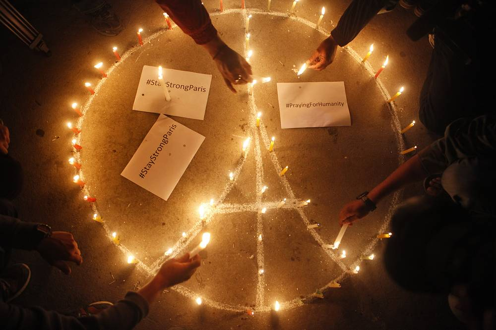 Nepalese people lighting candles for the victims of Paris terror attacks in Kathmandu, Nepal