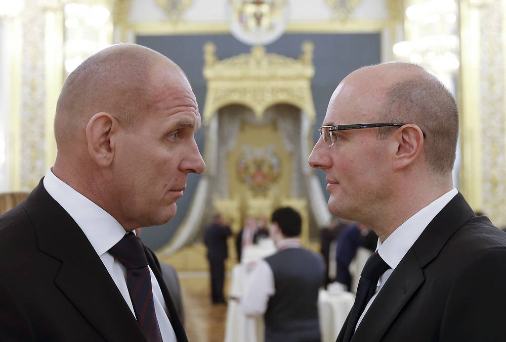Russian State Duma member Alexander Karelin (L) and Dmitry Chernyshenko, Chairman of the Board at Gazprom Meida Holding