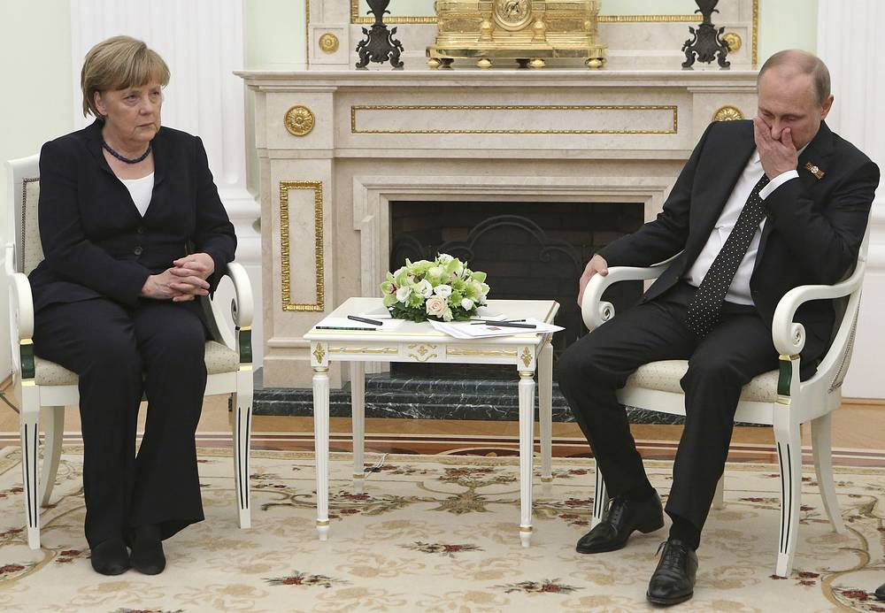 Russian President Vladimir Putin and German Chancellor Angela Merkel in Moscow's Kremlin, Russia, May 10, 2015. Angela Merkel attended a wreath-laying ceremony at the Tomb of the Unknown Soldier, marking the 70th anniversary of the defeat of the Nazis in World War II, in Moscow