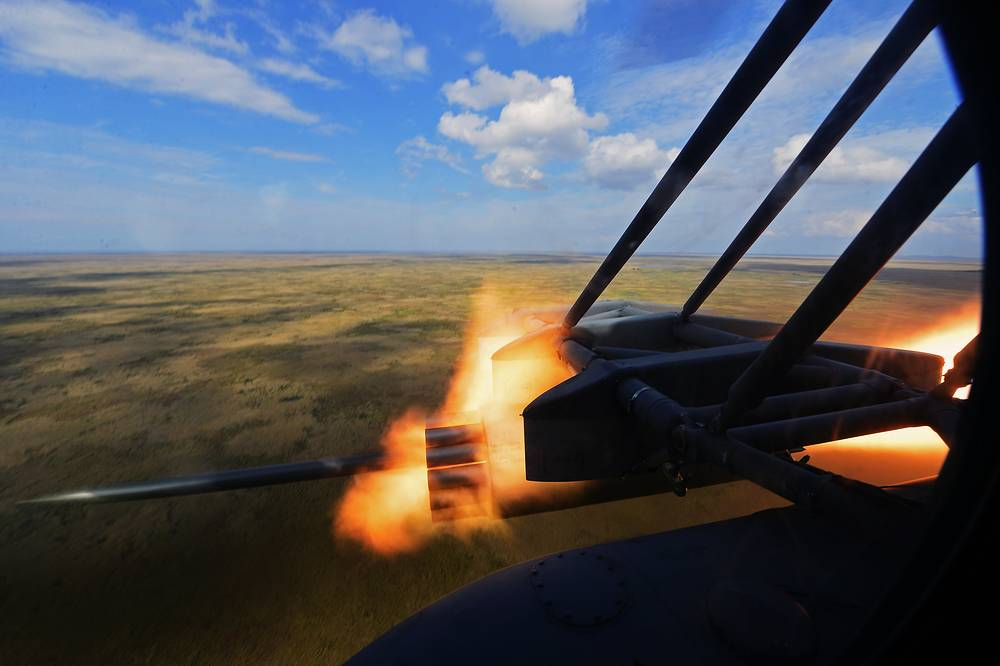 A Mi-8AMTSh transport assault helicopter firing free flight rockets during tactical flight training exercises, September 24, 2015