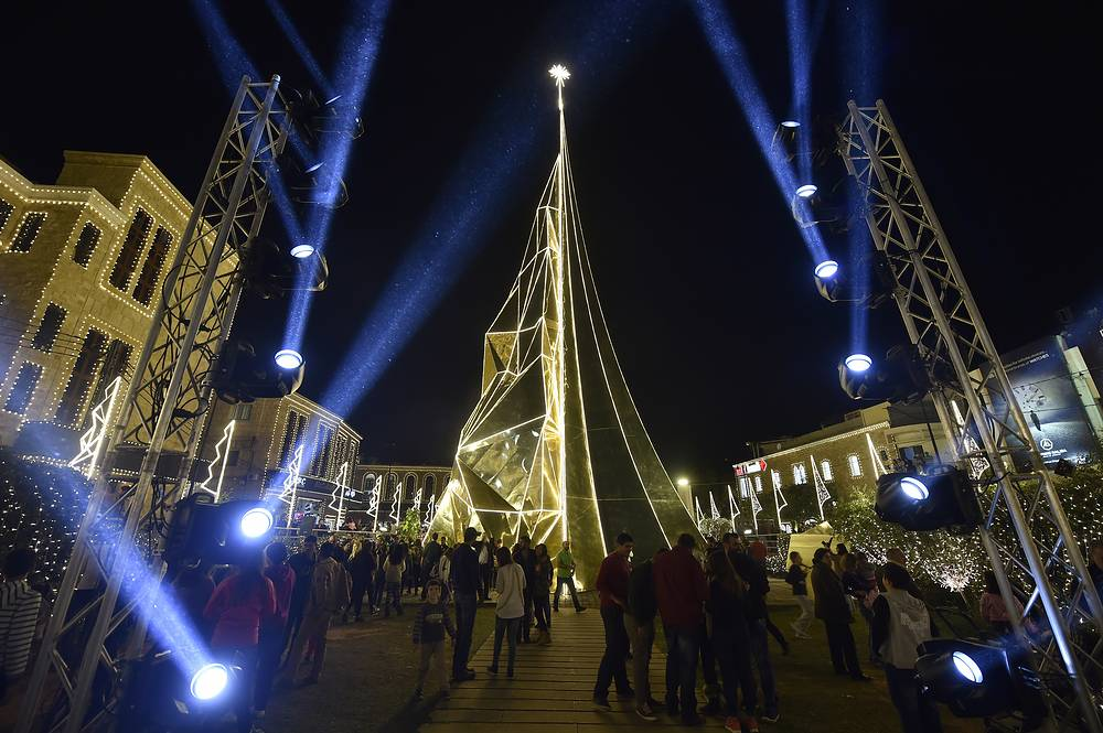 35-metre high Christmas tree, which was lit up under slogan 'let there be light' at the entrance of Byblos (Jbeil) north Beirut, Lebanon. Christmas tree divided into two parts symbolizes the past and present of Jbeil City in a modern style. The tree is composed of 35 tons of gold-colored mirrors made of steel the northern side of the tree is facing the sea and is designed in a sail shape in reference to the ancient city