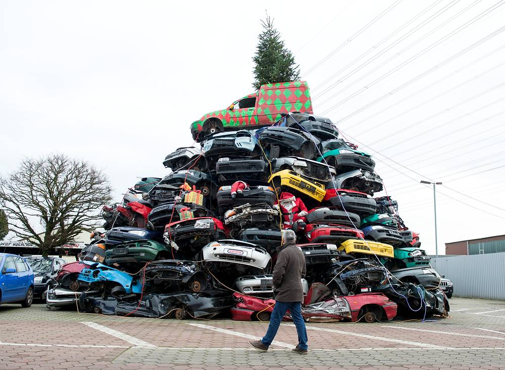 A pile of dozens of junk cars decorated for Christmas by employees at a car junkyard in Hamburg, Germany