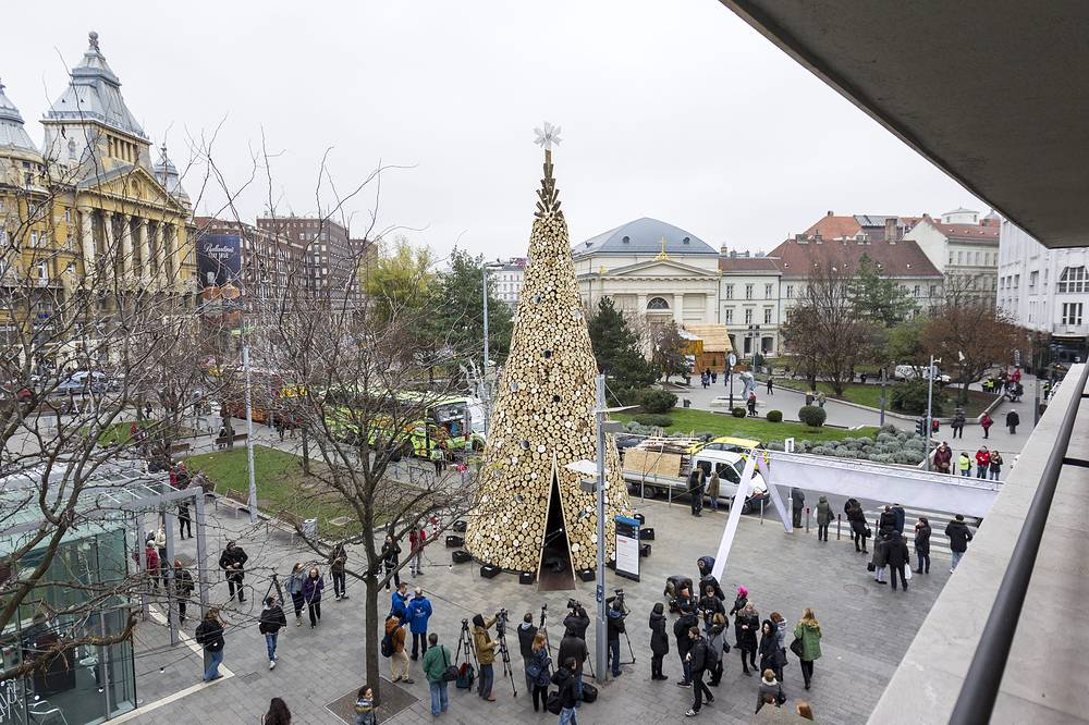 16-meter high Christmas tree erected by Hello Wood design studio in central Budapest, Hungary. The tree with a basic area of 30 square meters was built of 40 tons of firewood that will be distributed among the poor after the holiday