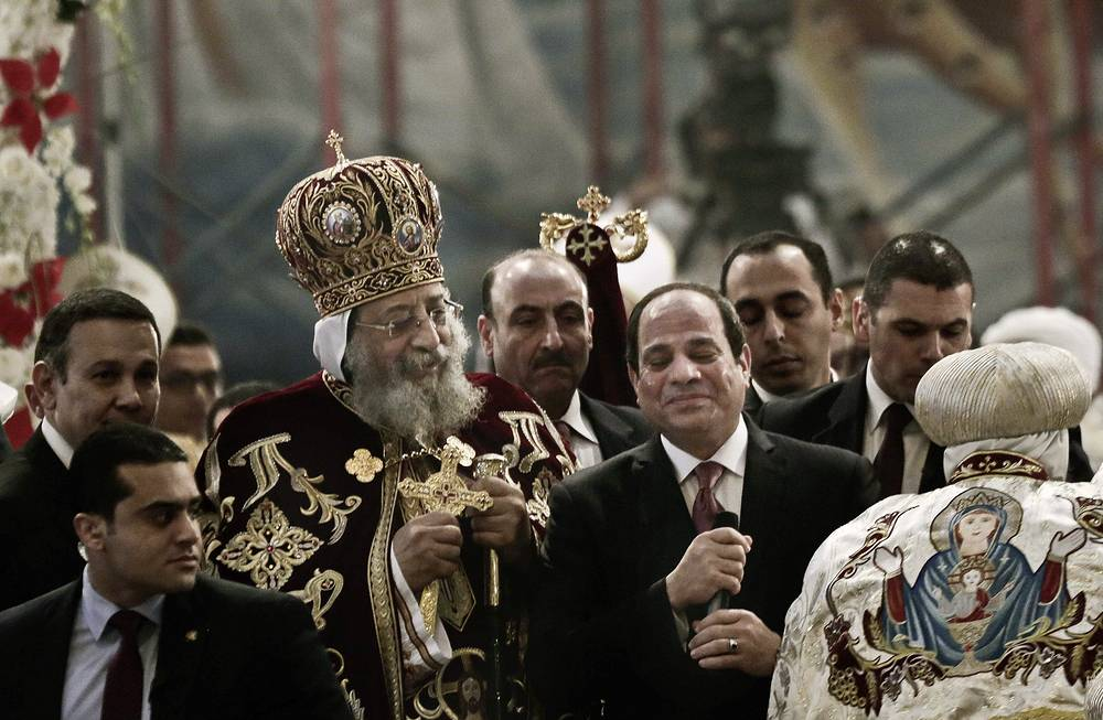 Coptic Pope Tawadros II and Egypt's President Abdel-Fattah el-Sissi seen during Christmas Eve Mass at St. Mark's Cathedral, in Cairo, Egypt