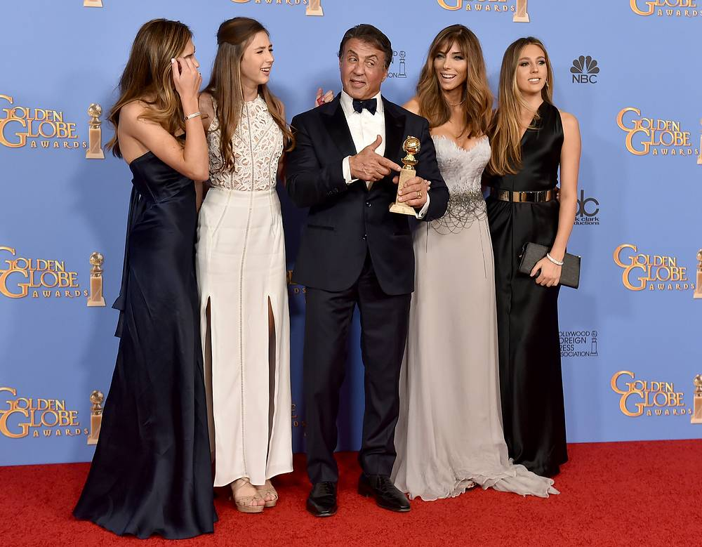 """Sylvester Stallone with the award for best performance by an actor in a supporting role in any motion picture for """"Creed"""" with Sophia Stallone, Scarlet Stallone, Jennifer Flavin, and Sistine Stallone"""