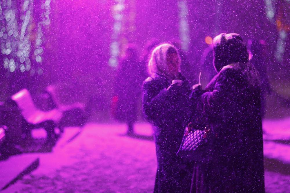 People walking in Tverskoy Boulevard during a snowfall in Moscow