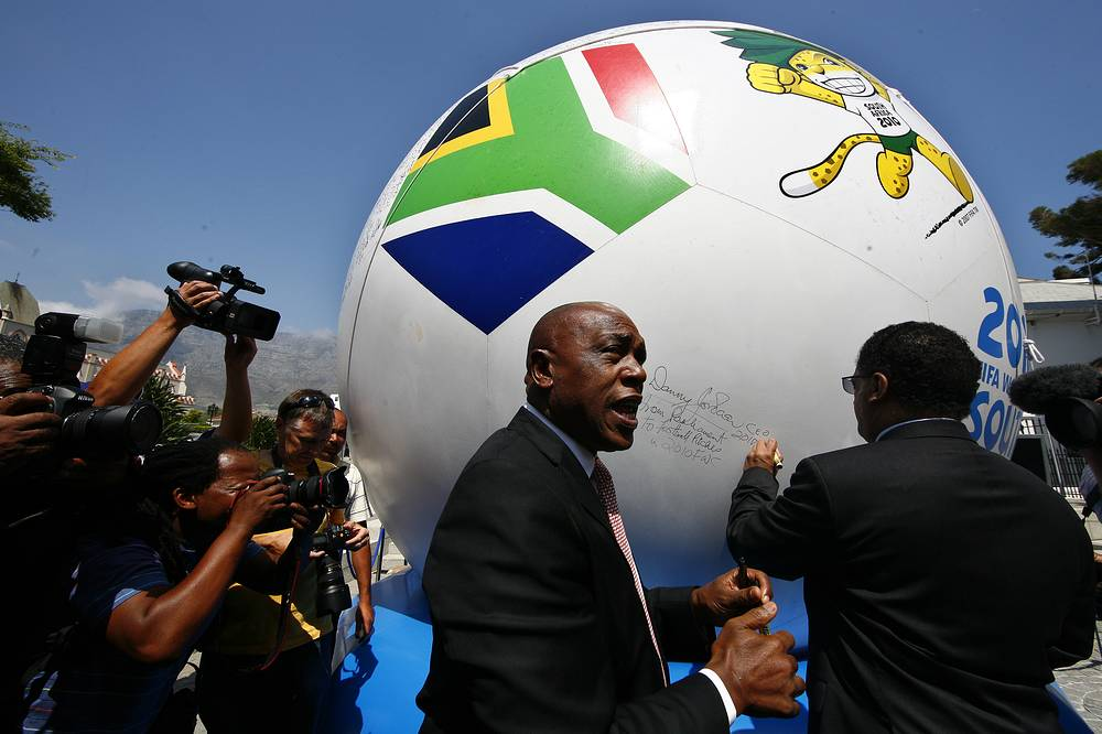 South African minister of Human Developments Tokyo Sexwale signing a giant soccer ball known as the Goodwill Ball outside parliament in Cape Town, South Africa