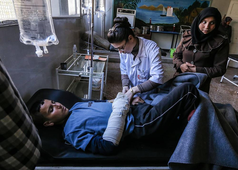 A man wounded in a mortar attack on Aleppo