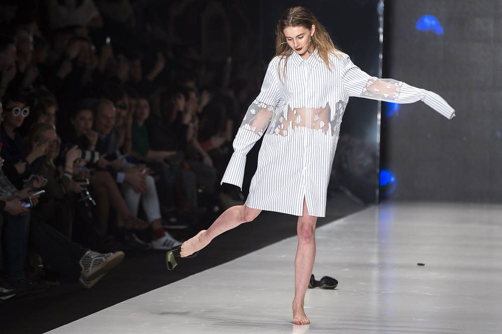 "A model loses her shoe as she displays a creation of Russian designers group ""Sorry, I'm not"""