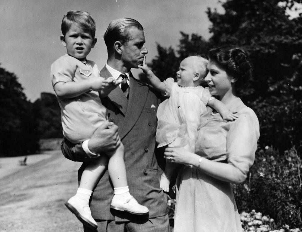 Princess Elizabeth stands with her husband Prince Philip, the Duke of Edinburgh, and their children Prince Charles and Princess Anne at Clarence House, the royal couple's London residence, August 1951