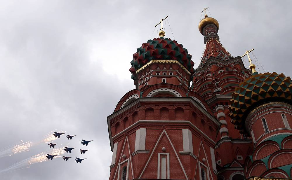 Su 27 and MiG 29 jets in flight over the Saint Basil's Cathedral