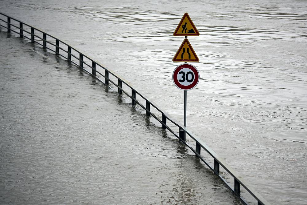 Paris City Hall closed roads along the shore of the Seine from the southwest edge of the city to the neighborhood around the Eiffel Tower as the water level has risen 4.3 meters (14 feet 1 inches) higher than usual