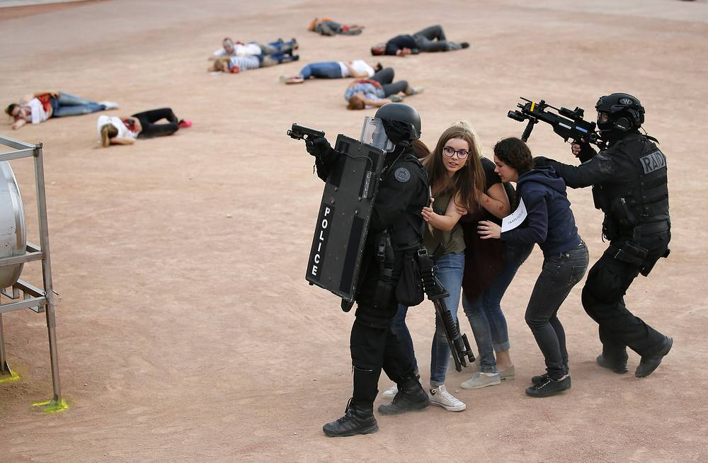 Anti-terror police officers and volunteer 'victims' take part in an anti-terrorism exercise at the Euro 2016 fan zone in Place Bellecour, Lyon