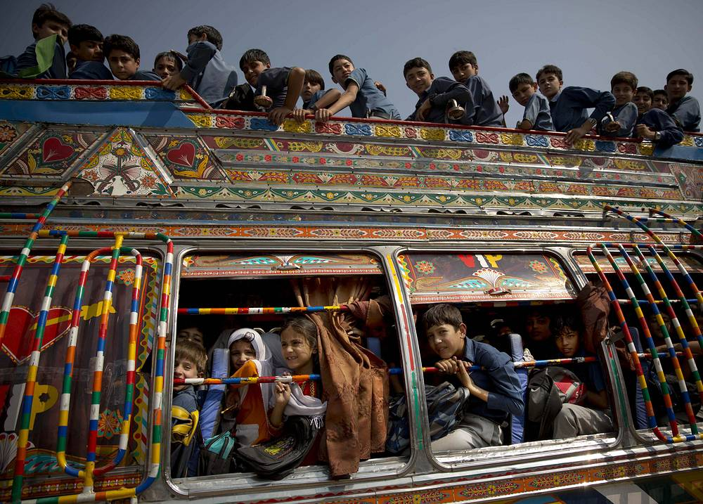 Pakistani children crowd on a school bus in Wajah Khiel, Swat Valley, Pakistan