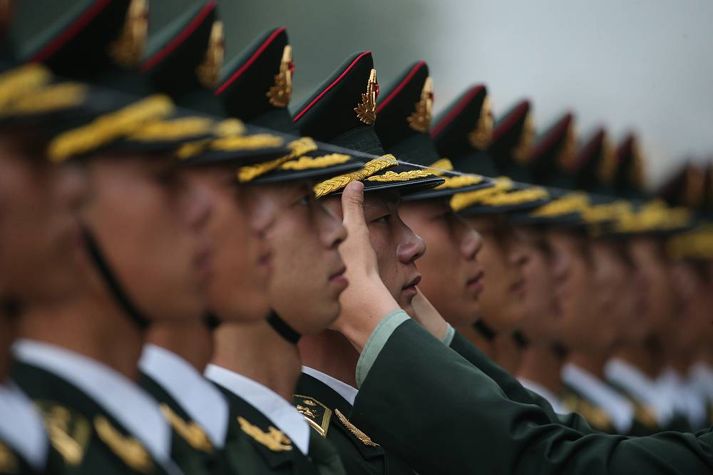 Members of People's Liberation Army honor guards at the Great Hall of the People in Beijing, China, 18 October