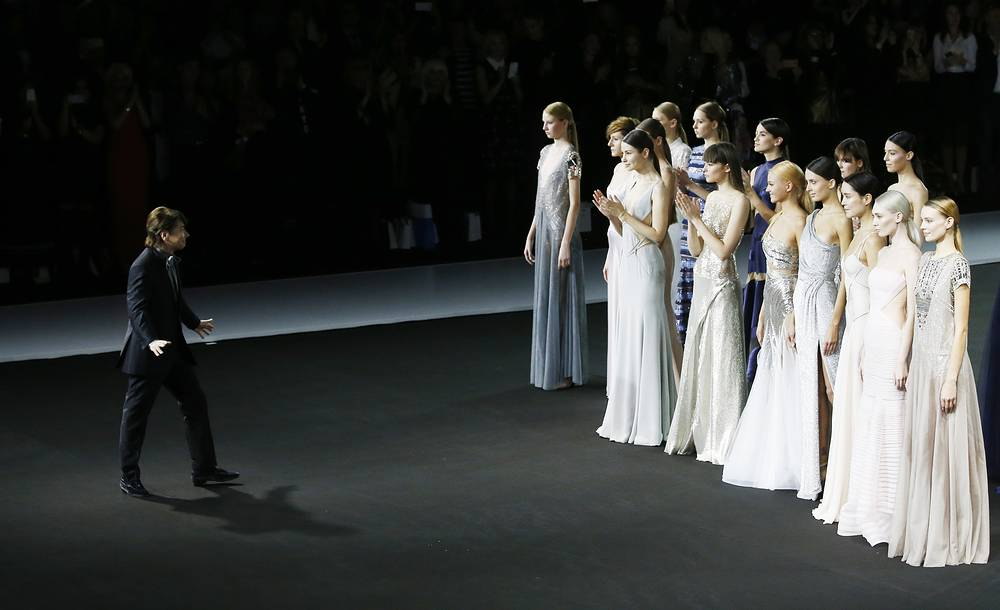 Russian fashion designer Valentin Yudashkin and his models at the opening of Fashion Week in Moscow, 18 October
