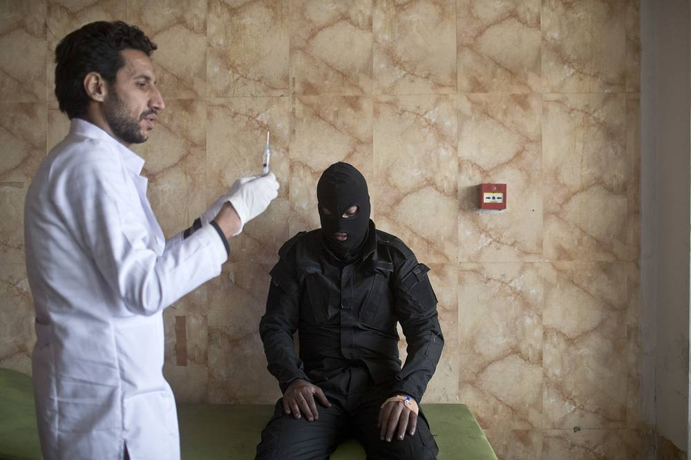 A member of the Iraqi security forces gets medical attention after inhaling sulfur fumes, at a hospital in Qayyarah, outside Mosul. Islamic State fighters torched a sulfur plant south of Mosul, sending a cloud of toxic fumes into the air that mingled with oil wells the militants had lit on fire to create a smoke screen
