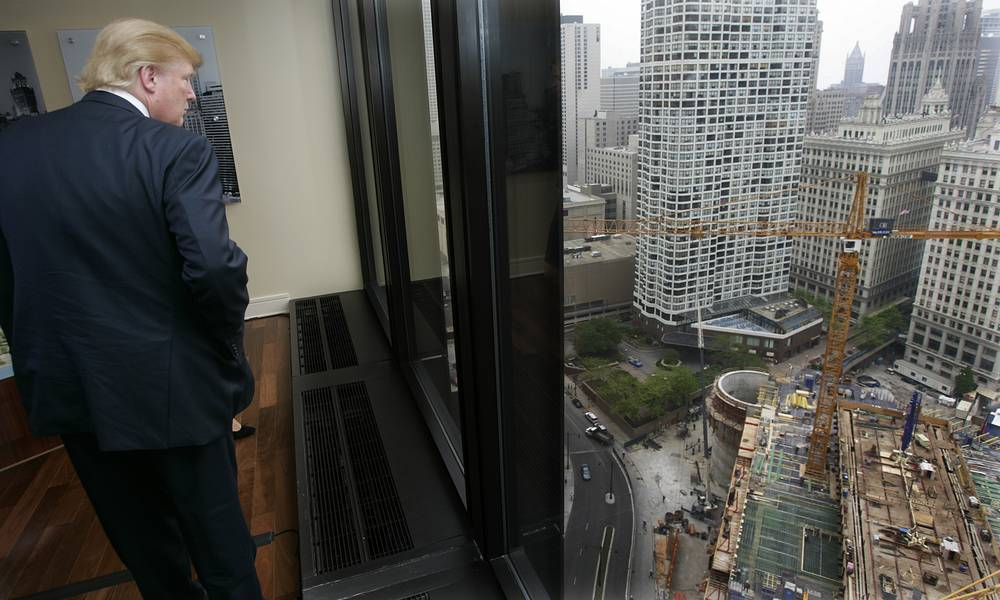 Donald Trump looks out at the construction site of his 92 story tower along the Chicago river, 2006